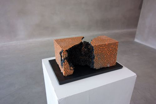 Jesse Greenberg, Cell Growth Orange with Black, 2014. Resin, pigment, bbs, 6 x 6 x 9 in, 15 x 15 x 23 cm
