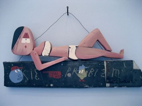 William Buzzell, White Trash, 2006. House-paint and shoe-dye on wood, 7 x 16 in, 19 x 41 cm