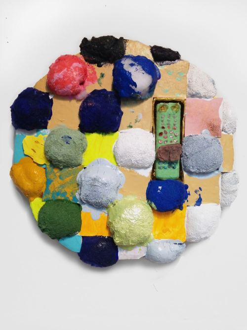 Brian Belott, TBT, 2017. Cotton batting, colorfast paper, acrylic paint, matte medium, remote control with matte medium, colored sand and stones, 21 x 21 x 5 in, 53 x 53 x 13 cm