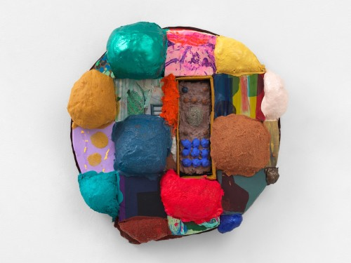 Brian Belott, Tondo Puff, 2019. Cotton batting, colorfast paper, acrylic paint, matte medium, remote control with matte medium, colored sand and stones, 21 x 21 x 5 in, 53 x 53 x 13 cm