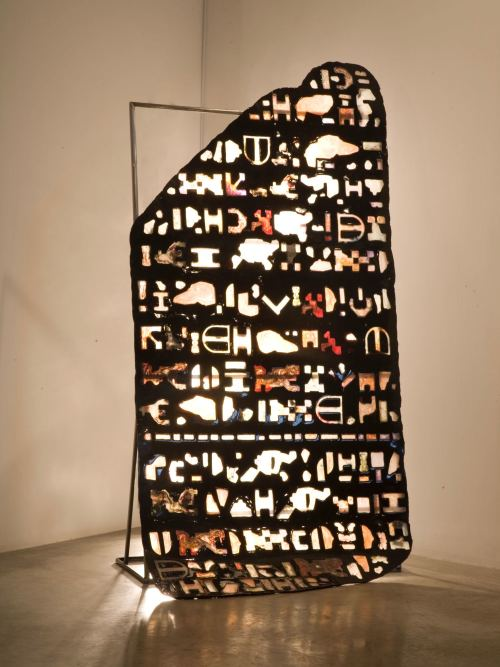 Jesse Greenberg, Clad Slouch, 2011. Resin, rubber, plastic, pigment, paper, steel, lighting, 96 x 48 x 24 in, 244 x 122 x 61 cm